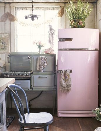 Someday, I want a vintage kitchen.  I *love* this pink fridge!