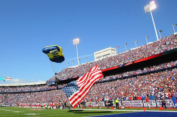 A member of the Navy Leap Frogs parachutes onto the field at Ralph Wilson Stadium on September 16, 2012 in Orchard Park, New York.