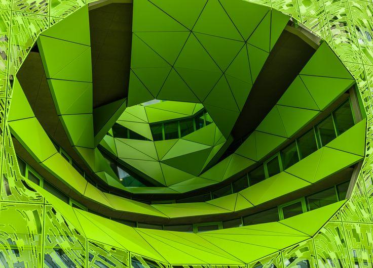 Le Cube Vert héberge le siège mondial de la chaîne d'information européenne Euronews. C'est un immense parallélépipède transpercé par deux atriums coniques offrant des vues sur le paysage environnant. La façade est doublée d'une résille d'aluminium ajourée monochrome vert conçue par l'artiste Fabrice Hyber. Cest l'œuvre des architectes Dominique Jakob et Brendan MacFarlane .