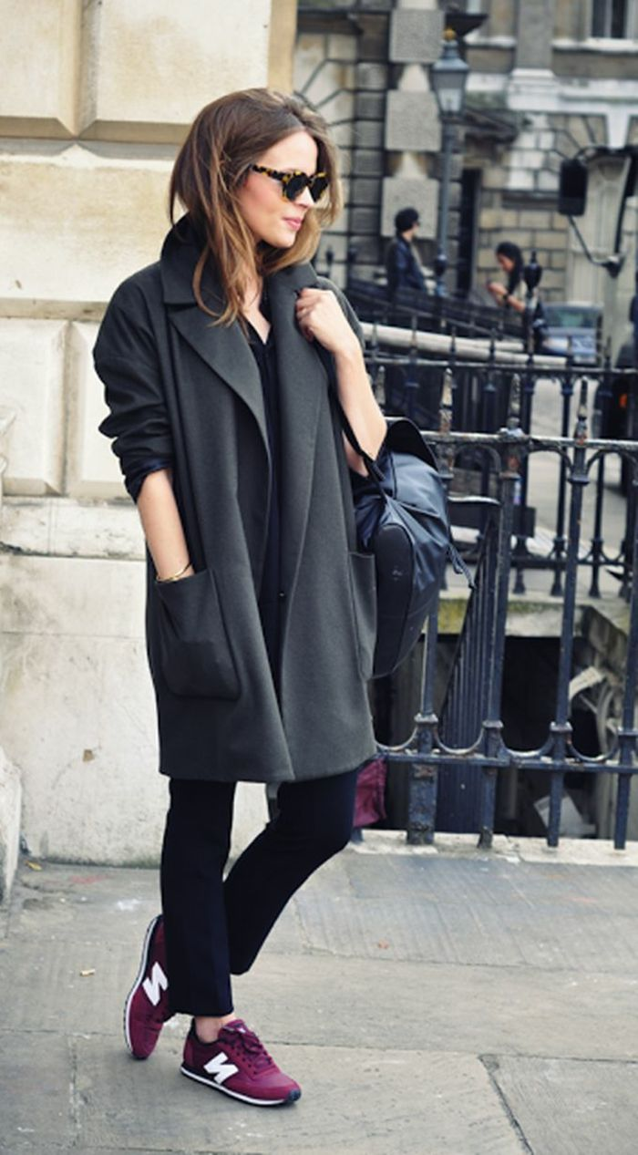 Women S Business Attire Black Trousers And Oversized Grey Coat Leather Bag Purple Sneakers Worn By Woman With Sungles