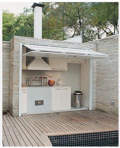 Outdoor Kitchen With Bifold Garage Door