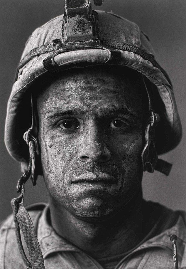 U.S. Marine Carlos 'OJ' Orjuela was photographed by Louie Palu after a mission in Helmand province. Exhibit of war photography at Houston Museum of FIne Arts. http://vimeo.com/49188174