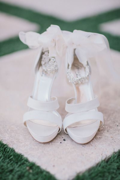 Pink Ribbon shoes: http://www.stylemepretty.com/florida-weddings/2014/05/14/garden-elegance-at-bella-collina/ | Photography: By the Robinsons - http://www.bytherobinsons.com/:
