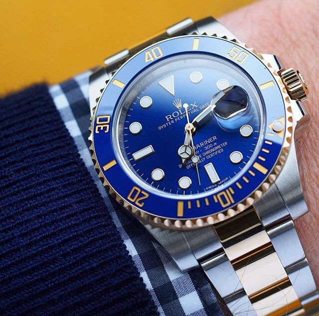 Rolex Submariner in two tone yellow gold and stainless steel.
