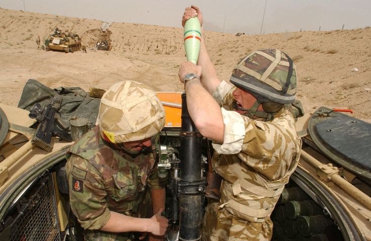 British soldiers engage Iraqi Army positions with their 81mm Mortars south of Basra 26 March 2003. [3600  2346]