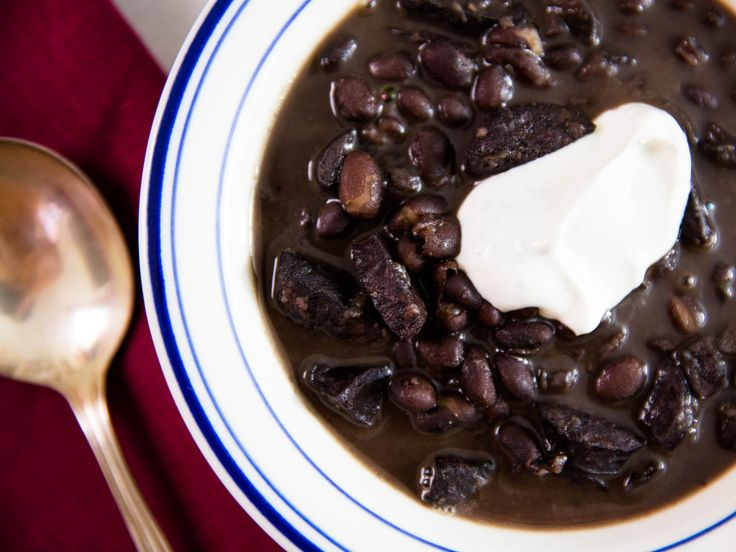 This easy black bean soup with smoky andouille sausage and diced mushrooms tastes like it cooked for hours, but thanks to the pressure cooker, it's ready in just one. A bright cumin-lime sour cream tops it off.