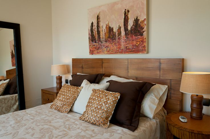 Bedroom decorated in earth tones very welcoming. Holiday rentals in Gran Canaria, Canary Islands.