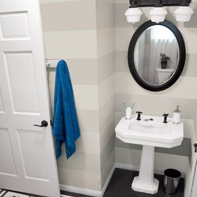 Benjamin Moore's Light Pewter and Nimbus painted in alternating wide wall stripes add subtle sophistication to this once boring bathroom. |    Photo: Roeshel Summerville | thisoldhouse.com