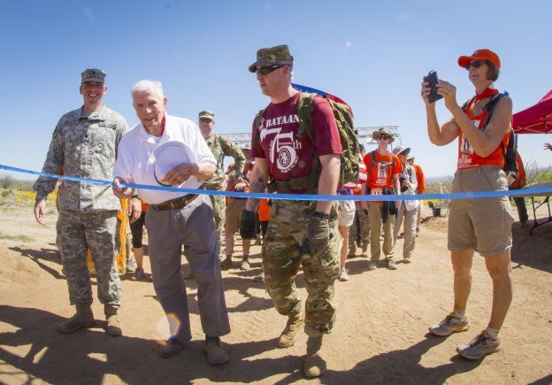 Retired U.S. Army Col. Ben Skardon, 99, a survivor of the Bataan Death March, crosses the eight-and-a-half mile finish line of the Bataan Memorial Death March for the 10th time, at White Sands Missile Range, N.M., March 19, 2017. (U.S. Army Reserve photo by Staff Sgt. Ken Scar)