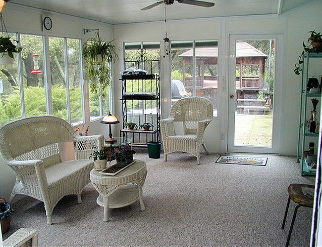 This beautiful, well-lit, tastefully decorated glass porch room looks wonderful. I've heard that these types of rooms can stay warm during winter months and cool during summer months without hardly any extra energy costs. I'll have to keep this option in mind as I think about adding on to my home to make it worth more.