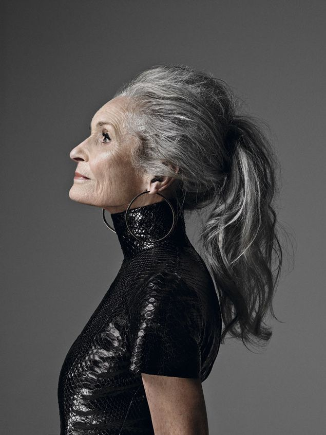 Daphne Selfe. 60 years old, great big long hair, healthy body, fancy earrings and make-up. Happy and amazing!