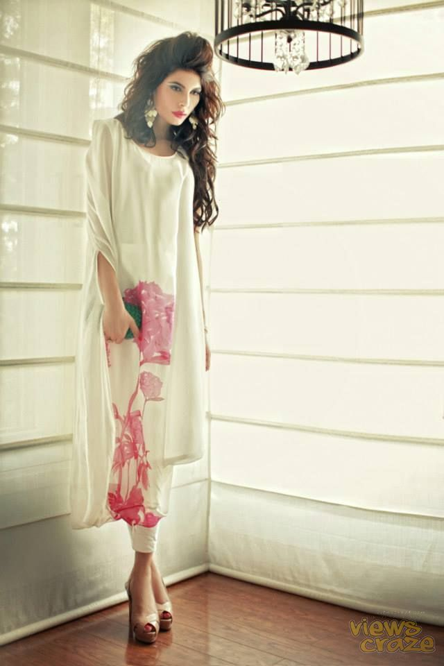 elegant white with pink floral color and design of the dress gives simple and eye catching look...