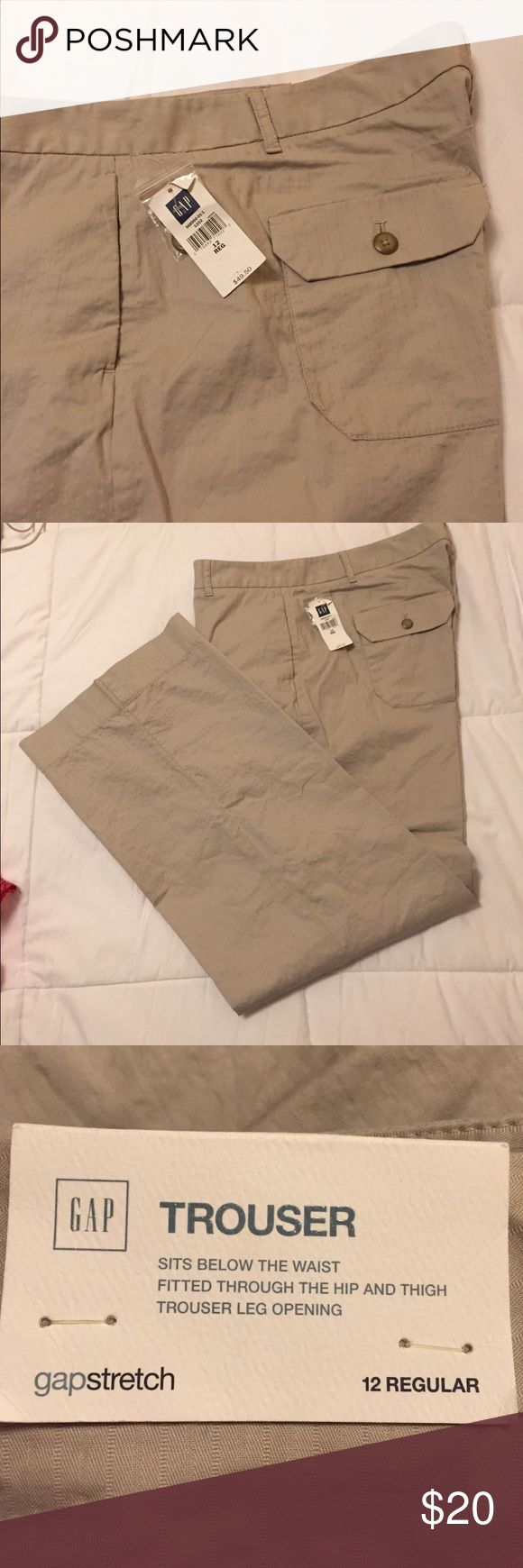 "GAP brand wide leg trousers Khaki colored GAP brand wide leg dress trousers. These have flap style pockets on the back with hidden pockets in front. Small hip pocket on right hip. There is s subtle pinstripe throughout the fabric. 31"" inseam. 97% cotton/3% spandex. Please ask for additional information if needed before purchasing. (True color is slightly lighter than images shown. I can't seem to find the right light.) GAP Pants Trousers"