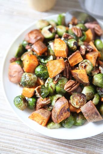 Roasted Sweet Potatoes And Brussels Sprouts With Pecans With Sweet Potatoes, Brussels Sprouts, Grapeseed Oil, Fisher Pecan Halves, Coarse Salt, Ground Pepper, Pure Maple Syrup, Balsamic Vinegar, Sriracha Sauce