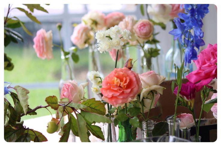 Pretty flowers in glass bottles