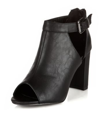 - Peeptoe front- Cut out sides- Buckle detail- Zip back fastening- Heel height:  3.5