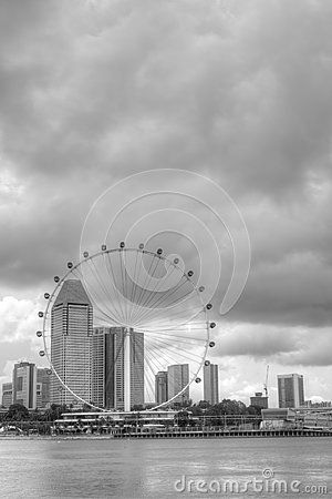 A dramatic rendition of the Singapore skyline featuring the Singapore Flyer