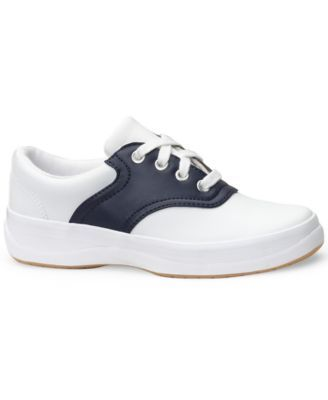 Practical for jeans, uniforms and casual dresses, these saddle shoes from Keds will take her from school days to afternoon play. | Leather upper/rubber sole | Imported | Lace-up saddle shoes from Keds