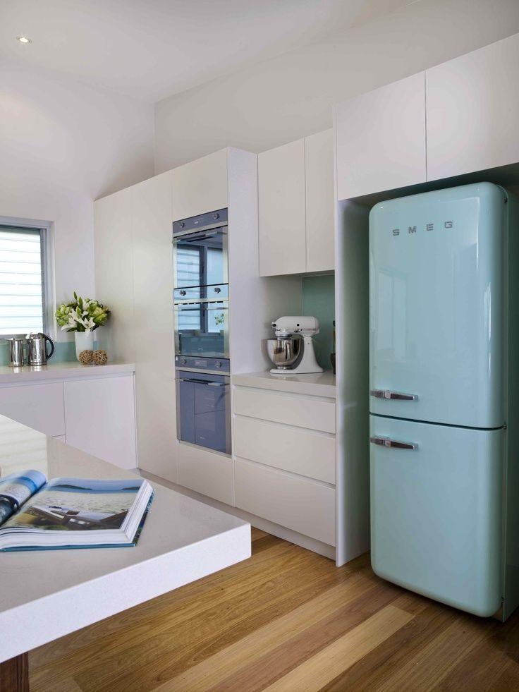 SMEG fridge in mint green + white kitchen