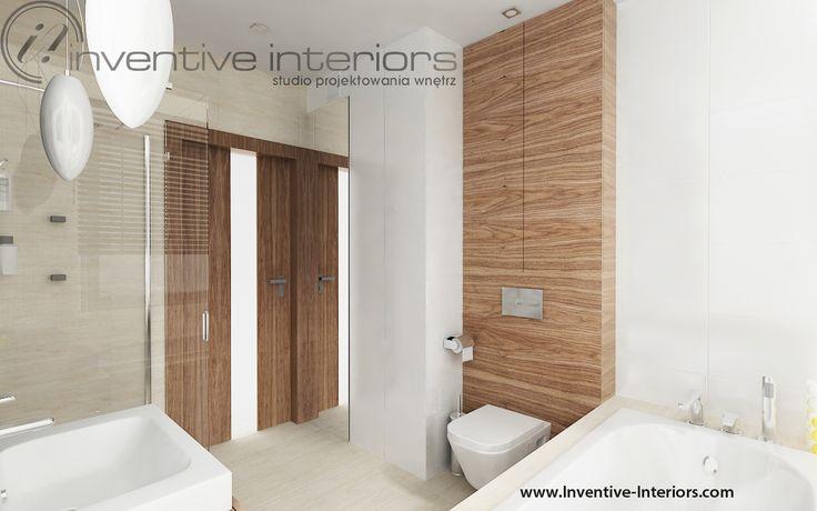 Projekt łazienki Inventive Interiors - beżowe płytki i zabudowy meblowe w bieli i orzechu w łazience
