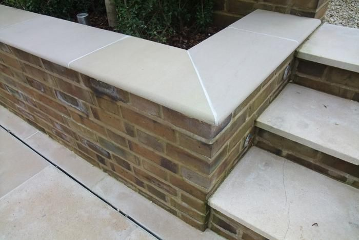 Bull nose coping stones. We'll have bricks on edge for coping, but I think bullnose detailing for the steps will be great.