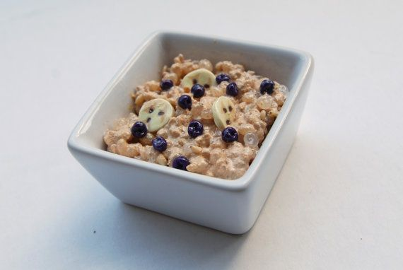 American Girl Doll Food. Breakfast Porridge with Bananas and Blueberries in a ceramic bowl