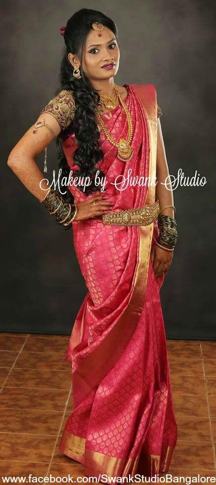 Traditional Southern Indian bride, Shruthi wears bridal silk saree and jewellery for her reception ceremony. Makeup and hairstyle by Swank Studio. Curls. Bridal hair. Kamarbandh. Silk sari. Tamil bride. Telugu bride. Kannada bride. Hindu bride. Malayalee bride. Bridal Saree Blouse Design. Indian Bridal Makeup. Indian Bride. Gold Jewellery. Statement Blouse.  Find us at https://www.facebook.com/SwankStudioBangalore