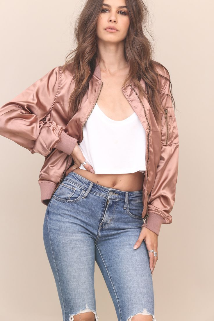 #shoplunab #lunabchristmas Padded satin bomber jacket. Side pockets with zipper closure. Front zipper closure. Fully lined. Style #: CT-7086 Material: Polyester/Spandex Color: Rose Gold Model is wearing a small