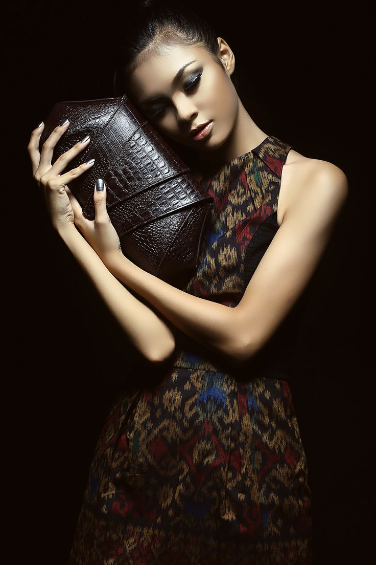 An Ethnicity inside a Glamorous Style  This dark brown crocodile clutch bag is one of Soka's rare leather clutch bags collection. It is created from fine Italian cow leather embossed of a crocodile skin pattern