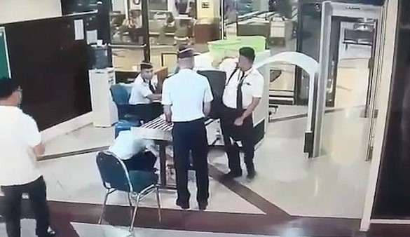 Pilot Capt. Tekad Purna pictures,'drunk' pilot stumbling through security