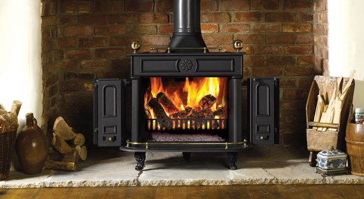 ben franklin stove | Small Stovax Regency stove with Brass rail set burning logs