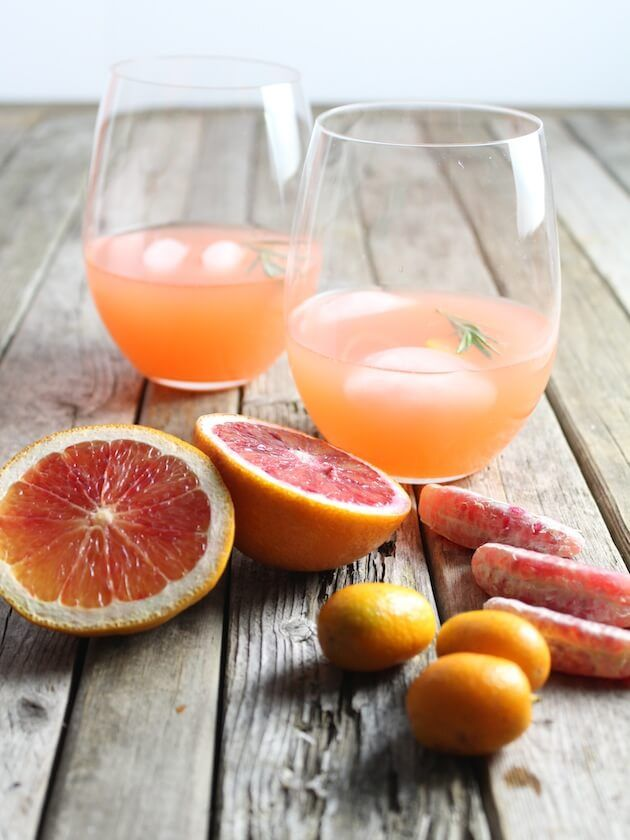 Aperol Punch with gin, lime juice, blood orange juice, orange juice, grapefruit juice, muddled rosemary, and sparkling white wine