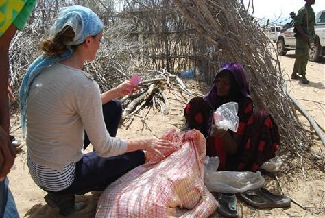 """Amanda Lindhout. A Canadian woman returns to Somalia to help fight the devastating famine plaguing the African nation, despite having previously been held prisoner in the country for 460 agonizing days. """"You look at the little kids here, and that's the whole reason,"""" Lindhout said tearfully."""