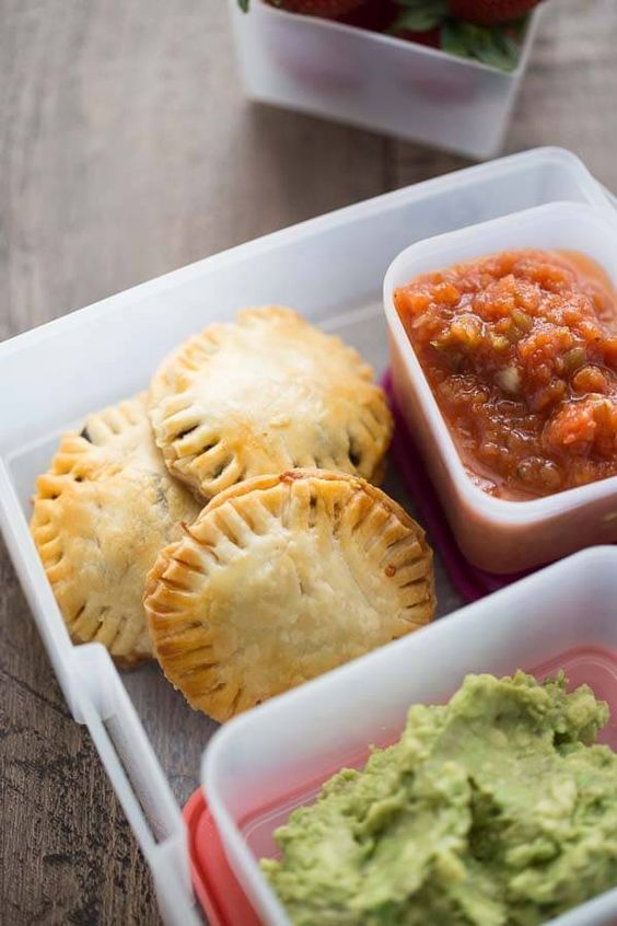 Mini savory hand pies filled a with a taco meat beans and cheese!