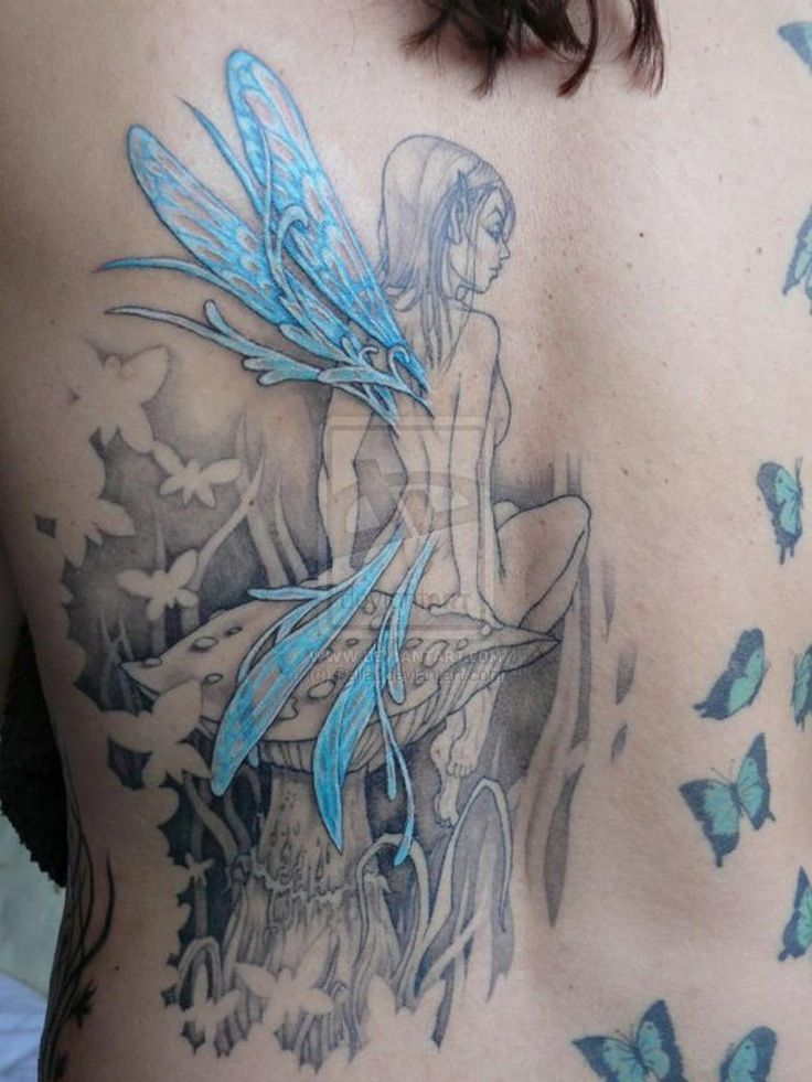blue fairy tattoo. I like the look of all black and grey, then adding one color.