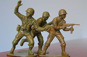 American figures were produced in U.S. Army green and molded in a variety of action poses — a little boy's war fantasy come true. Sold in large plastic bags, demand for the little green men rose in the 1950s thanks to a boom