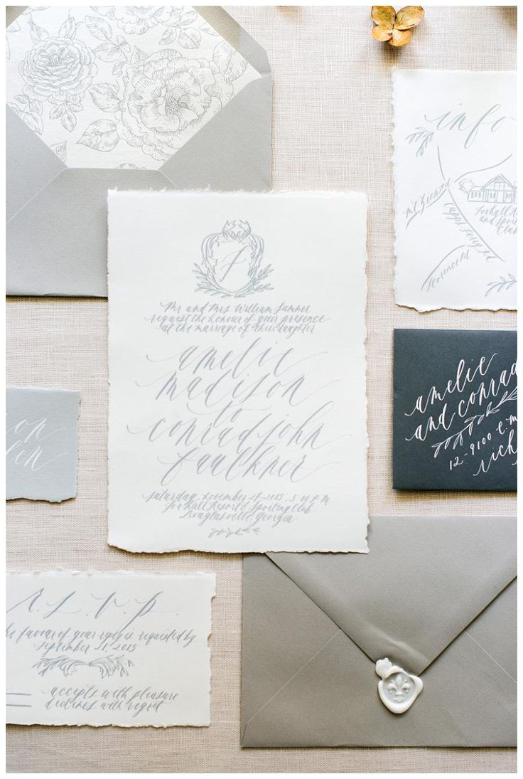 Soft, dove gray wedding invitation suite from Written Word Calligraphy + Design. Image by Rustic White Photography.