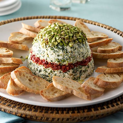 This savory layered cheese spread is a welcome addition to any gathering.