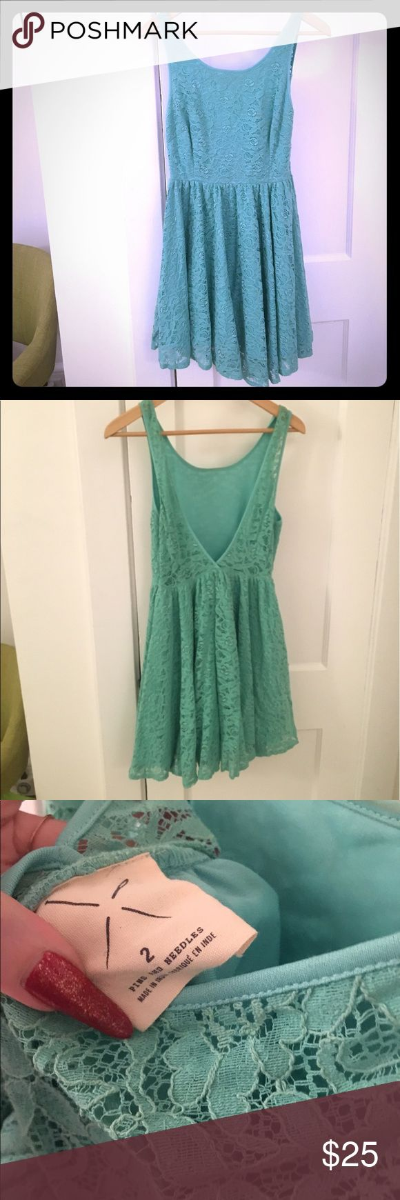 Urban Outfitters turquoise lace dress size 2 Lace swingy dress purchased at Urban Outfitters. Size 2. Open back. Great preowned condition. Pins & Needles Dresses