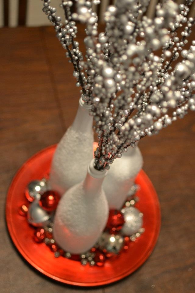 my christmas centerpiece using wine bottles, epson salt and my fave red and silver bells.