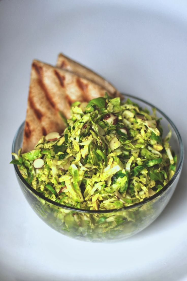 Shredded Brussels sprout salad with almonds lemon-mint tahini dressing