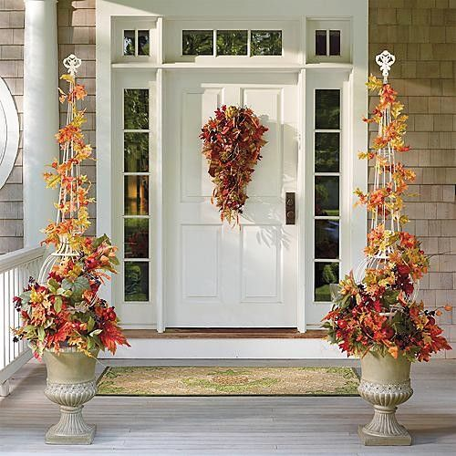 Falling leaves topiary in urn arrangement traditional - Christmas decorating exterior house ...