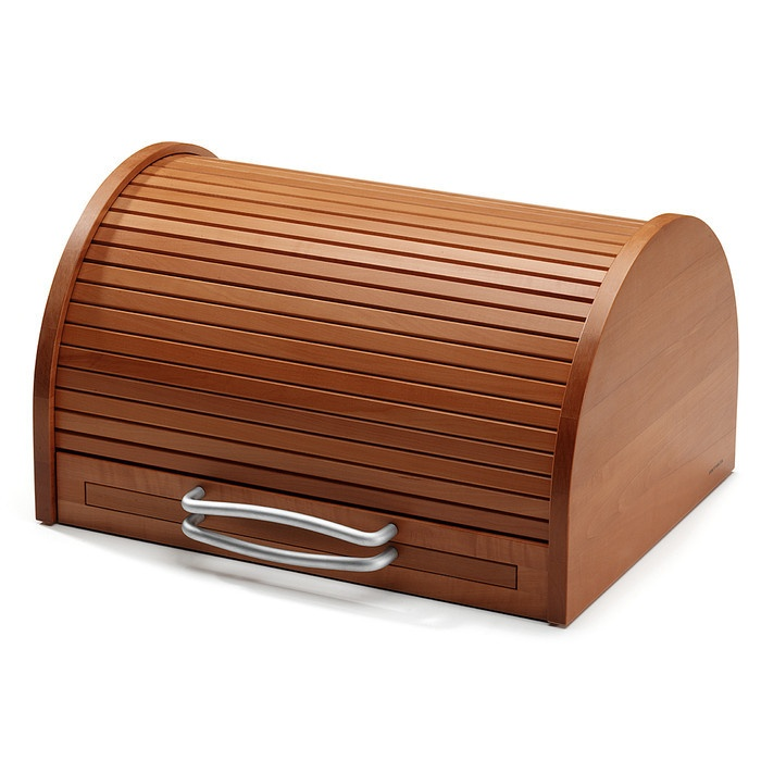 This is a miraculous breadbox which rolls open automatically when you pull the crumbtray / base out. However, at €395, I know this will just remain a purely inspirational pin.     Mitheis Brotkasten Birnbaumholz | Aufbewahren
