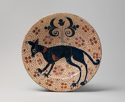 Date:1400–1450  Geography:Made in, probably Manises, Valencia, Spain  Culture:Spanish  Medium: Tin-glazed earthenware  Dimensions:Overall: 13 5/8 x 2 3/16 in. (34.6 x 5.5 cm)  001 - FRONT