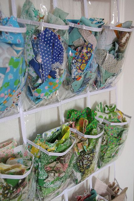 """sewing scraps organised with a shoe holder, hanging from back of """"sewing room"""" door.  Could also hold threads, notions, etc."""