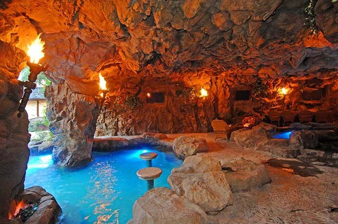 A Luxurious Pool With A Waterfall And A Cave At Old Lion