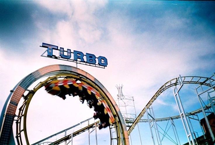 """40x50cm mount and frame (white-painted grainy wooden frame 3cm wide and 1.2cm deep, framed by Rin Tin Tin of Brighton).28x43cm image size.Shot on a Lomo LC-A , loaded with Lomography Chrome 100 film, which was cross processed. The famous """"Turbo"""" ride on Brighton's Palace Pier.(To save on postage, it is also possible to collect from my home in Brighton. Simply type in COLLECT at the check out, and let us know when you want to stop in!)"""