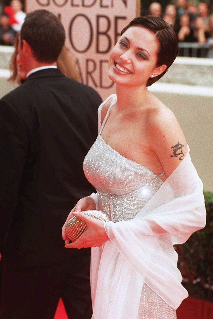 Track Angelina Jolie's style history, from goth to glam