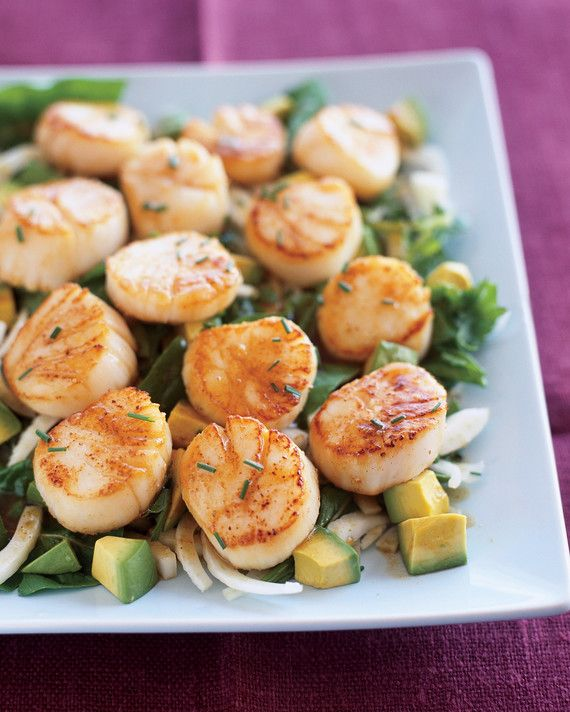 Sweet sea scallops need only a dusting of salt and pepper before going into a hot skillet. The accompanying salad of fennel, parsley, arugula, and avocado is tossed in a rich and tangy dressing made with pomegranate molasses.