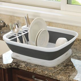Collapsible Dish Rack at CHEFS. My new best friend in the kitchen! It collapses so you can neatly store it under the sink. Sturdy enough to hold my cast iron pots!